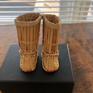 Hand woven miniature boots.